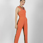 First look: J0024 ($149.99) Tangerine orange double creep stretch jumpsuit w/tribal print contrast.