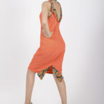 Second look: J0027 ($149.99) Tangerine orange double creep stretch dress/ tribal printed detailing.