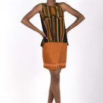 Sixth look: J0011 ($64.99)Tribal print & black sheer silk top with tribal print insets. Paired with J0012 ($69.99) Rusty orange suede asymmetrical skirt.