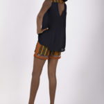 Ninth look: J009 ($84.99) Navy blue silk sheer sleeve with cotton blouse Tribal print detailing paired J0010 ($79.99) with Tribal print shorts with rusty orange suede & clear plastic inserts.